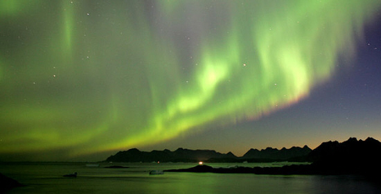 A view of the night sky showing the northern lights over Greenland